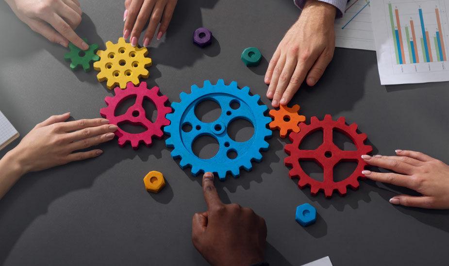 team success cogs symbolic image